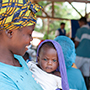 Mother and child at mobile health clinic