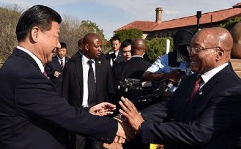 President Jacob Zuma welcomes President of China Xi Jinping on a state visit to South Africa at the Union Building in Pretoria