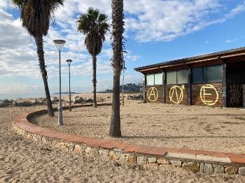 House with anarchist symbols on the beach